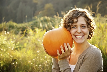 Girl Holding a Pumpkin